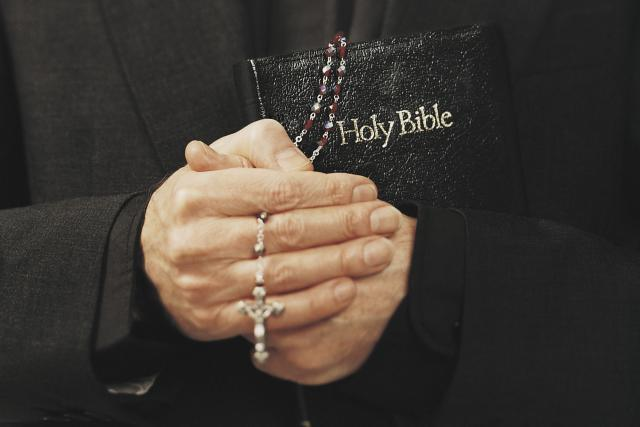 Priest-With-Bible-and-Rosary.jpg