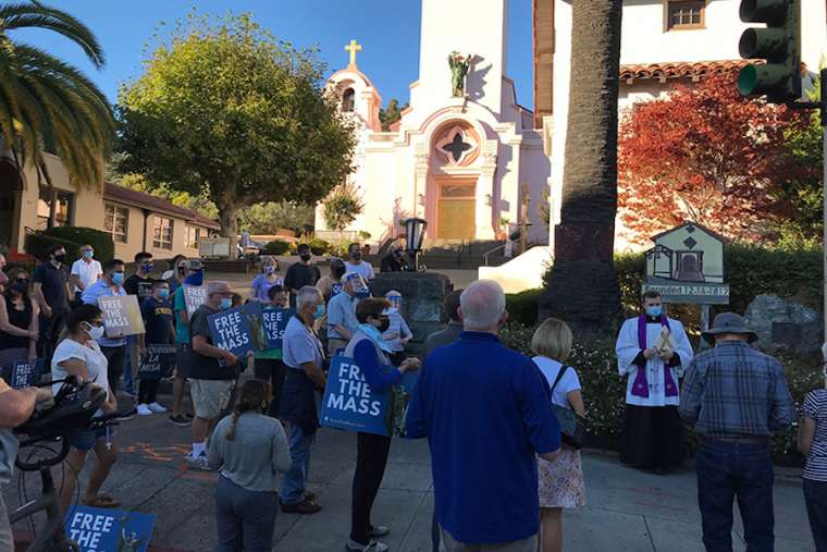 Father_Kyle_Faller_leads_prayers_at_the_site_of_a_destroyed_statue_of_St_Junipero_Serra_on_Oct_13_2020_Credit__Valerie_Schmalz_Archdiocese_of_San_Francisco.jpg