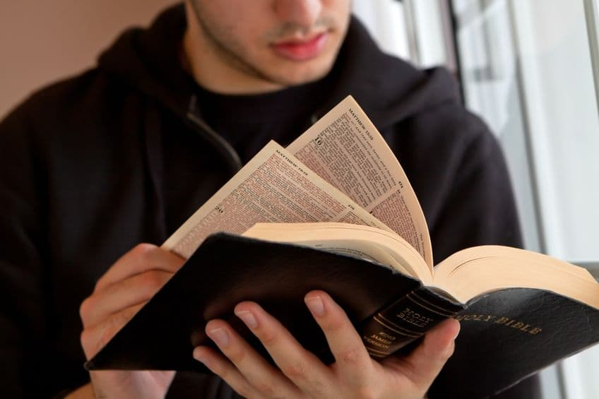 Young-man-reading-the-Bible.jpg
